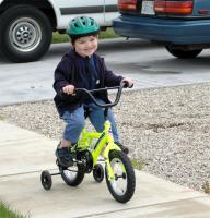 Ben riding bike, side view